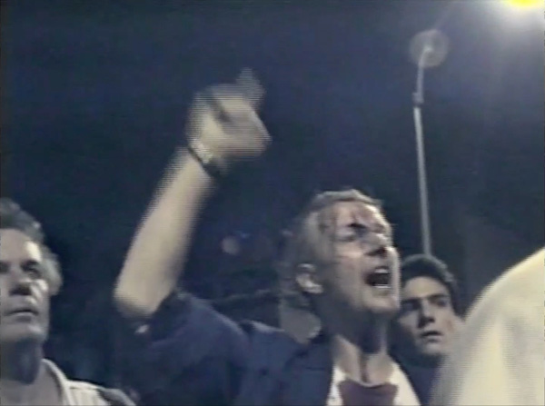 On August 6, 1988, New York City police attempted to enforce a curfew during a rally held at Tompkins Square Park. Clayton Patterson filmed the event on his VHS camcorder and his footage captured multiple incidents of police brutality, leading to the indictment of six police officers. Courtesy Clayton Patterson.