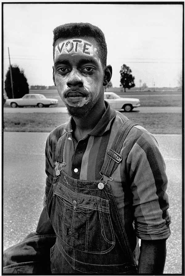 "Bruce Davidson, USA. Alabama. 1965. Young man with ""Vote"" painted on his forehead walking in the Selma March, 1965 © Bruce Davidson/Magnum Photos"