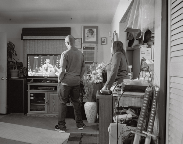 LaToya Ruby Frazier, Denise and Rodney Clay, Shea's aunt and uncle, watch President Obama take a sip of Flint water on television, 2016, from the series Flint is Family Courtesy the artist, Gavin Brown's Enterprise, New York/Rome, and Michel Rein, Paris/Brussels