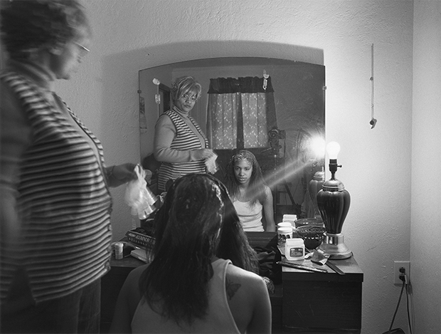 LaToya Ruby Frazier, Mom Relaxing My Hair, 2005. © LaToya Ruby Frazier