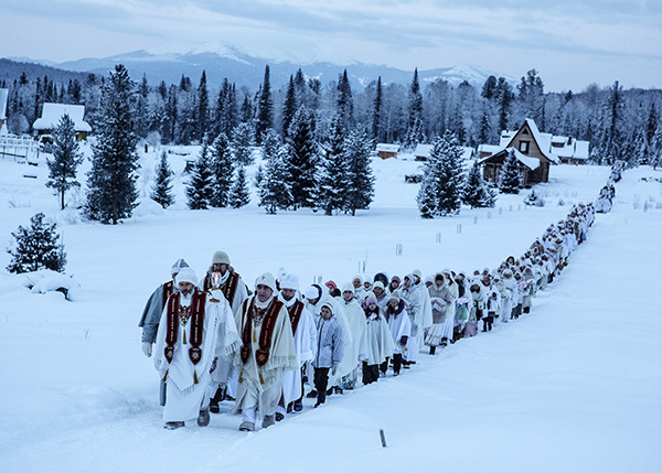 Jonas Bendiksen, On January 14, Vissarion's birthday, his disciples enter the community's innermost and holiest village, Obitel Rassveta, or The Abode of Dawn, Russia, 2015 © the artist/Magnum Photos